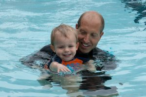 one with the water, infant swim lessons, infant swimming