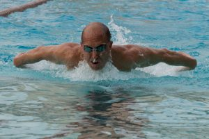 Strength coach, strength, get stronger, swim coach, swimmer, man swimming